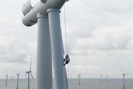 Siemens' service rope access technicians installing the power curve upgrade at Horns Rev wind farm by accessing the blades by rope.