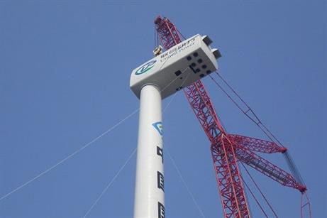 Guodian's 6MW offshore wind turbine prototype under installation on the beach of Weifang in east China's Shandong province.