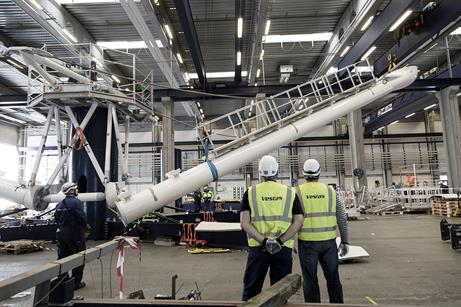 Each arm of the test turbine has a footbridge from the central technician platform to nacelle