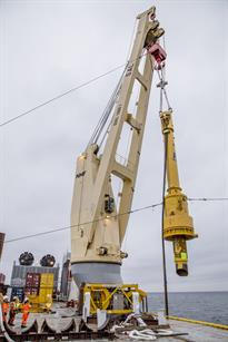 Piling hammer moving into position