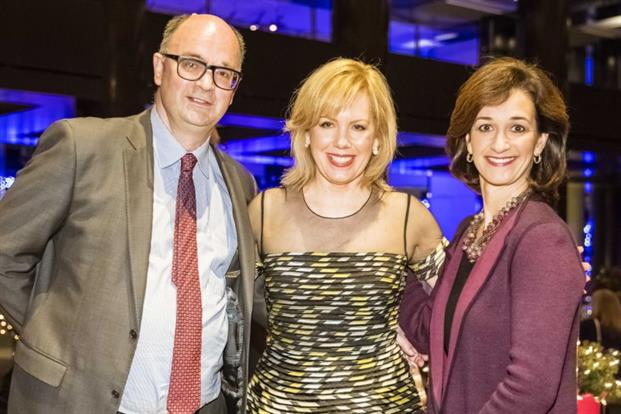 Editorial director of PRWeek global Steve Barrett (left) congratulates Southwest Airlines' Ginger Hardage (center) on her induction to the PRWeek Hall of Fame