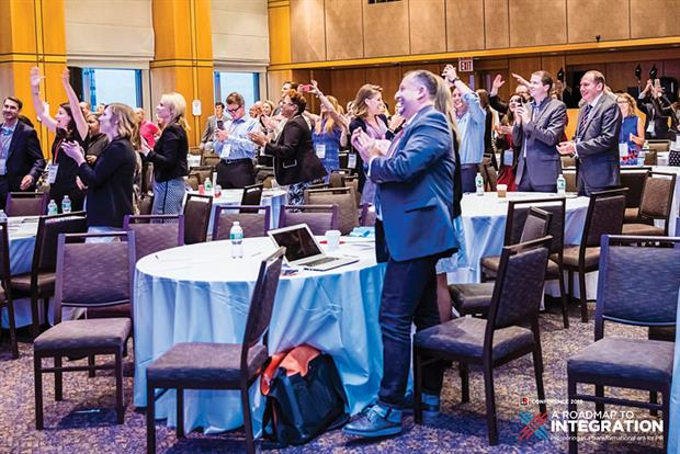 The attendees applaud the closing keynote (and singing) delivered by Progressive Insurance CMO Jeff Charney.