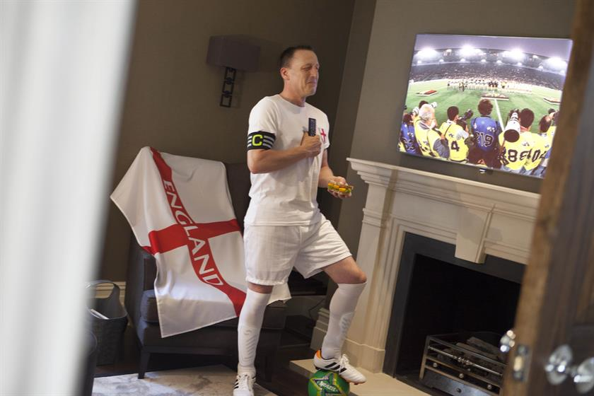 John Terry, holding a fish finger sandwich, weeps in front of the TV while swearing allegiance in his England kit.
