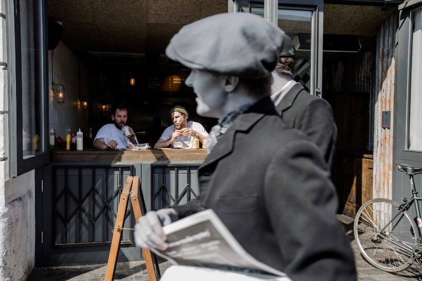 Newspaper boys take to the streets of London to warn of the 'Monogram Murders' (and promote the latest Hercule Poirot whodunnit)