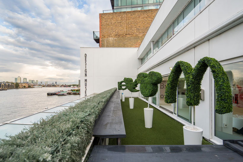 Brands on the balcony: Hedges trimmed into the shape of brand logos at the Design Museum in London, part of the Like me: Our bond with brands exhibition.