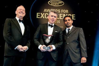 Peter Duffy is presented with his Marketing Leader of the Year award by SapientNitro's Nigel Vaz