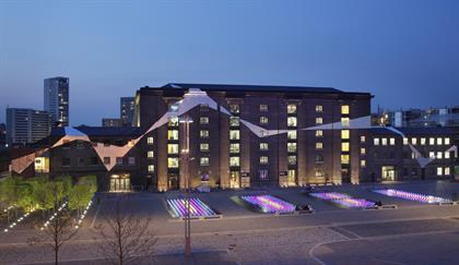 Granary Building, home to Central Saint Martins College of Arts and Design, at dusk