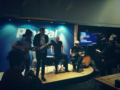 The band playing in the PayPal social media lounge is called 'Coin'.