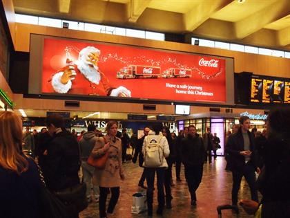 Coca Cola spreads Christmas cheer among rail commuters...