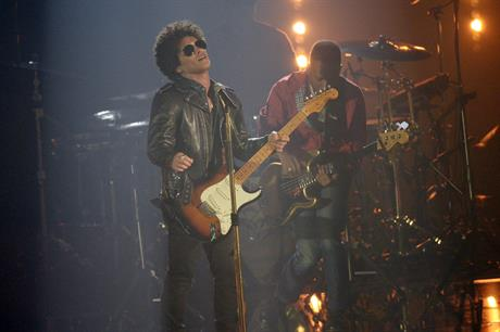 Bruno Mars performed with a band and pole-dancer