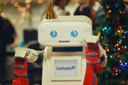 Brian the Robot at office Christmas party in Confused.com ad