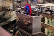 Proximity assistant scales building dressed as Superman