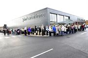 Shoppers Queue on opening day at the John Lewis at home store in Poole