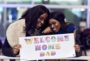 Watch: Heathrow and street artist create customised 'Welcome home' banners