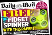 Daily Mail publisher reports tough ad market is improving