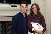 Kevin Jonas: pictured with his wife Danielle who is cradling a bottle of Dreft