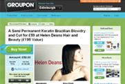 Groupon trims losses to $3.59m