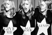 Madonna: premiers 'give me all your luvin' on Clear Channel screens around the world
