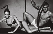 Beckham: posing with his wife in Armani ad
