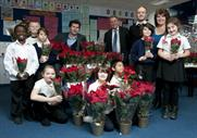 Greg Hill (back centre) with schoolchildren and Sun garden writers Steve and Val Bradley