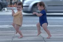 Evian babies street dance with adult selves