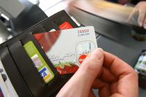 Tesco delays banking launch until 2013