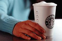 Starbucks bows to pressure over UK tax