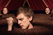 Costa Coffee: seemingly disembodied heads in a sea of coffee beans sing Kiss in this memorable ad.