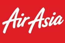 Fernandes to use Air Asia as fallback shirt sponsor