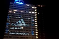 Adidas targeted with giant 'exploitation' projection at Olympic Park