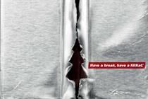 KitKat's 'ritual' foil-tear shows Christmas tree in tactical poster ad