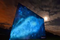 O2 erects giant blank canvas that transforms into the Milky Way at night