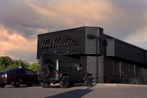 Canadian coffee store Tim Hortons blacks out premises to promote Dark Roast