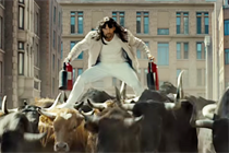 A bewigged Jason Statham 'bull surfs' in a Statham fantasy world for bizarre LG spot