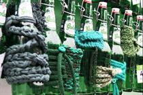 Watch: graffiti artists build giant installation with 400 Grolsch bottles