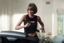 Taylor Swift falls off a treadmill for Apple Music's 'Distractingly Good' spot