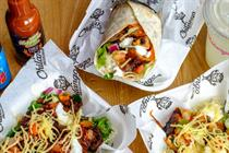 Uber takes on Deliveroo with London launch of food delivery service