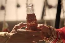 In India, Coca-Cola breaks ice after arranged marriage