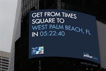 JetBlue Billboard gives travel time to vacation spots ... and sends you there for free