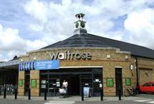 Waitrose profits hit as shoppers lap up free tea