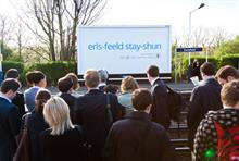 Commuters observe JCDecaux's Google voice search mobile app campaign at Earlsfield station