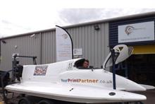 Your Print Partner director Stuart Maclaren with some of the work it has produced for the F2 Powerboat World Championship