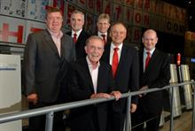 Buxton Press CEO Bernard Galloway (front centre) and Heidelberg CEO and chairman Bernhard Schreier (second from right) celebrate deal with colleagues at Drupa