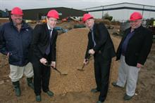 Holland (r) breaks ground in 2007 with Brett Reynolds (l) and Robin Ryan of Dennis