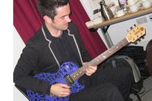 Musical director Dave Marks demoes a 3D printed guitar