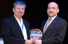 Plowman accepts the award at Drupa