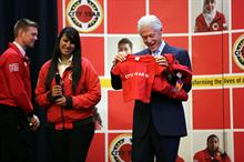 Celebrities: Bill Clinton receives a T-shirt for his granddaughter at a City Year UK event