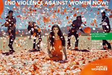 Watch: Benetton 'stones' woman with flowers to end violence
