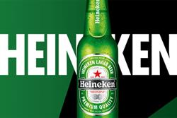 Heineken paints pubs green for London 2012