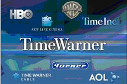 Time Warner strikes online TV deal with Comcast